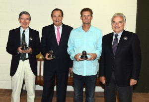 From left : Frew McMillan (RSA) Cliff Drysdale (RSA) and Wayne Ferreira (RSA) receive the Davis Cup Commitment Award from ITF President Francesco Ricci Bitti at Wimbledon this week.