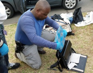 An officer discovers the drugs from the linings of the laptop bag