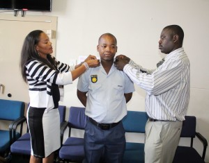 Hawks members remove ranks from Constable Mpho Matsoso shortly after arresting him