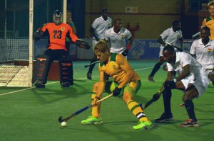 SA captain and midfielder Tim Drummond in possession as defender Charles Abbiw of Ghana challenges during the Greenfields Africa Hockey Championship match at Randburg Hockey Stadium Tuesday night. SA won 4-0.
