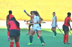 Goalscorer Dirkie Chamberlain (12) is embraced by SA captain Nicolene Terblanche (obscured) as Jade Mayne (27) looks on during the Greenfields Africa Hockey Championships match against Kenya at Randburg Hockey Stadium Thursday.