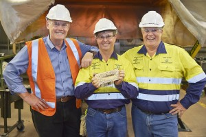 (from left) Peter Bradford, CEO of IGO, Duncan Gibbs, GM Tropicana, and Michael Erickson, SVP Australia. They are holding the 1 Moz gold bar.