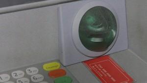 Card skimmer on ATM machine