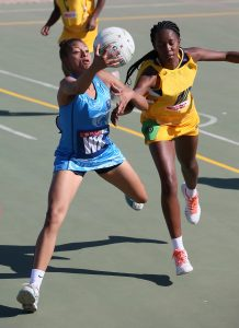 Roche de Reuck of Western Cape (Left) and Lentsa Motau of Mpumalanga in action during day 4 of the 2016 Spar National Netball Championships at Hoy Park Sports Complex on August 11, 2016 in Durban, South Africa.