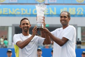 (Left) Raven Klaasen of South Africa with his doubles partner, (Right) American Rajeev Ram after winning the Chengdu Open Doubles title on Sunday played at Chengdu, China.